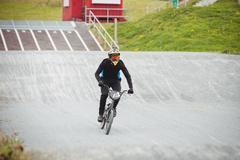 Cyclist riding BMX bike Stock Photos