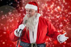 Composite image of santa claus singing song Kuvituskuvat