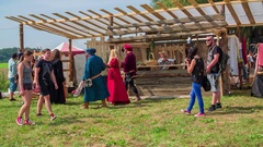 Visitors are walking around the medieval festival Stock Footage