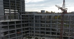 Aerial view of construction crane near unfinished concrete building in city Stock Footage