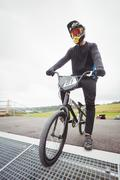 Cyclist preparing for BMX racing at starting ramp Kuvituskuvat