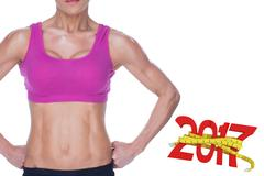 3D Composite image of female bodybuilder posing in pink sports bra and shorts Stock Photos