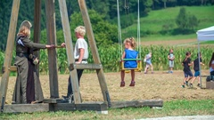 Children are playing on swings Stock Footage