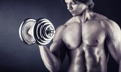 Exercising with dumbbell Stock Photos
