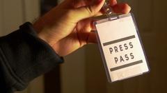 Presspass press pass hold Stock Footage