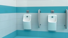 Row of urinals at public toilet Stock Footage