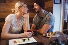 Couple having sake drink in restaurant Stock Photos