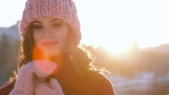 Close up Winter portrait of a young smiling woman in a pink hat and gloves Stock Footage