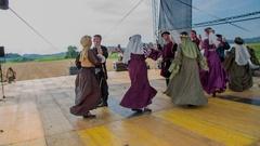 Women are dancing around their men Stock Footage