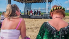 Visitors are watching performers dancing on stage Stock Footage