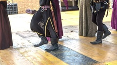 Dancing a traditional medieval dance on stage Stock Footage