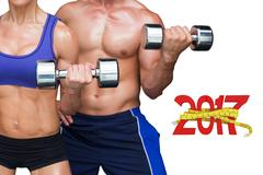 3D Composite image of bodybuilding couple Stock Photos
