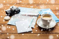 Close up of notepad with map and travel tickets Stock Photos