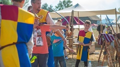 Young boys are competing in an archery tournament Stock Footage