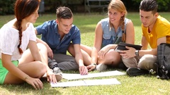 Teenagers studying together at park Stock Footage
