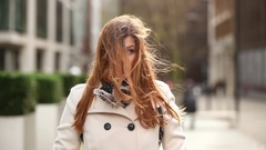 Portrait of a beautiful woman with hair tousled by the wind Stock Footage