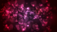 Red and pink glowing bokeh hearts video animation Stock Footage