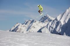 Ski rider jumping on mountains. Extreme ski freeride sport Stock Photos