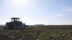 Tractor cultivating a field Stock Footage