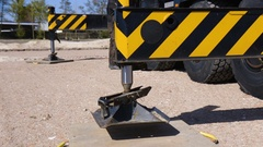 Mobile crane extending its legs Stock Footage