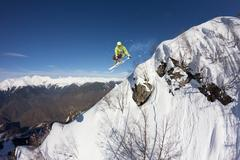 Ski rider jumping on mountains. Extreme ski freeride sport Stock Photos