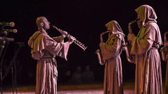 Playing saxophones in traditional costumes from medieval times Stock Footage