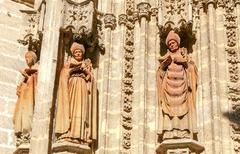 Sevilla. Sculptures on Cathedral. Stock Photos