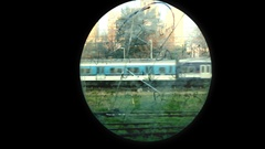 Train Passes through an Oval Window of an Old Wagon Stock Footage