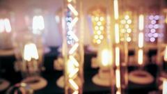 Glowing light bulbs. Defocused background. Stock Footage