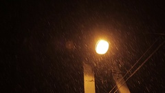 First snow descends on the night city street Stock Footage