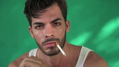 Young Hispanic Man Smoking Cigarette And Blowing Smoke Stock Footage