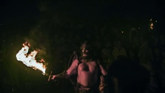 Fire-eater is performing for the audience Stock Footage