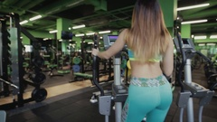 Woman in fitness center make a cardio exercise Stock Footage