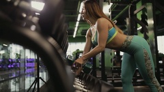 Strong woman doing exercise in gym. She lifting dumbbell. Stock Footage