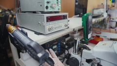Scientist solder, looking through a microscope in the laboratory Stock Footage