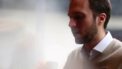 Man sipping coffee Stock Footage