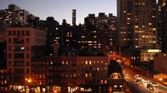 Sunset aerial view of Midtown Manhattan and 2nd Avenue (left to right shot) Stock Footage