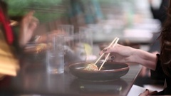 Woman eating sushi with chop sticks Stock Footage