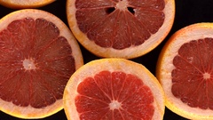 Rotating slices of grapefruit Stock Footage