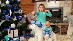 Girl singing while having fun playing with a toy during the winter holiday Stock Footage