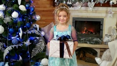 Girl child gives a box with a present, a gift for Christmas, a cute little girl Stock Footage