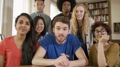 4K Happy group of student friends making a video call in shared accommodation Stock Footage