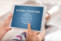 Global sourcing concept on a tablet Stock Photos