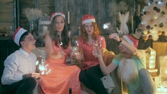 Group of happy laughing friends raising hands near Christmas tree. Christmas Arkistovideo