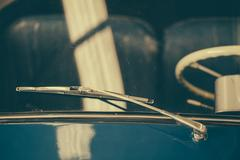 Old car retro vintage classic vehicle windshield and rain wiper. Stock Photos