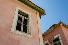 Large pink ruined mansion from Portuguese colonial times in Angola Stock Photos