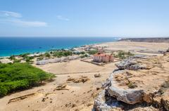 Small fishing village Mucuio with dominating Portuguese colonial building Stock Photos