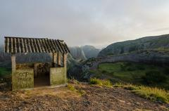 Fog and concrete hut at Black Rocks of Pungo Andongo or Pedras Negras in Ango Stock Photos