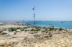 Radio antenna with the sea and town Lobito, Angola in background Stock Photos