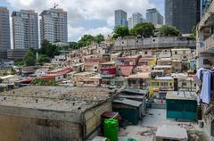 Colorful illegal houses of the poor inhabitants Luandas Stock Photos